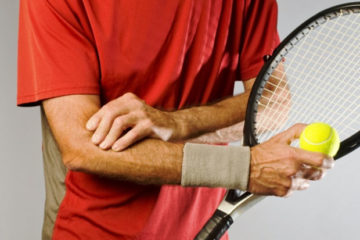 male tennis player with tennis elbow