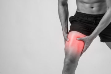 young-sport-man-with-strong-athletic-legs-holding-knee-with-his-hands-pain-after-suffering-ligament-injury-isolated-white_1150-2942